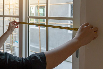 Measuring a window for shutter installation
