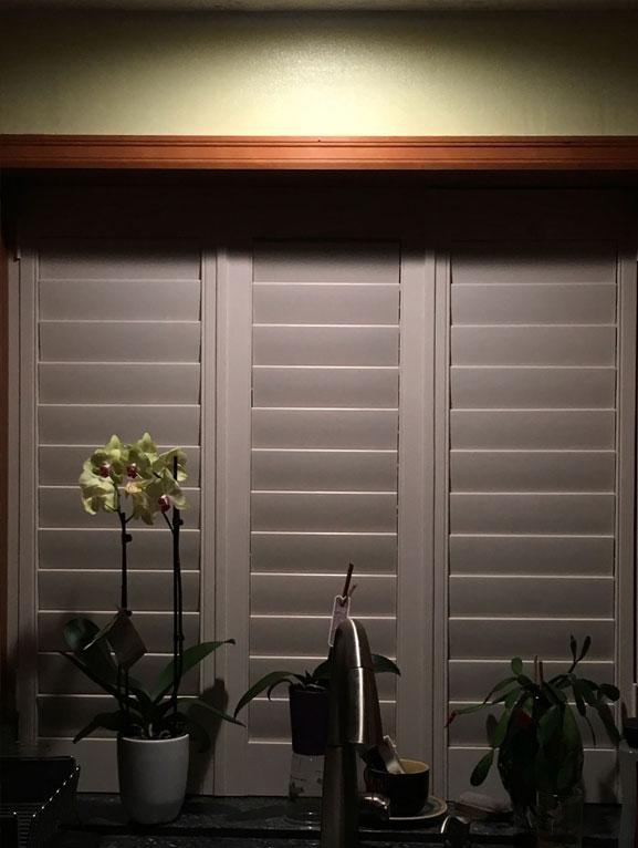 Wooden Shutters on A Kitchen Window