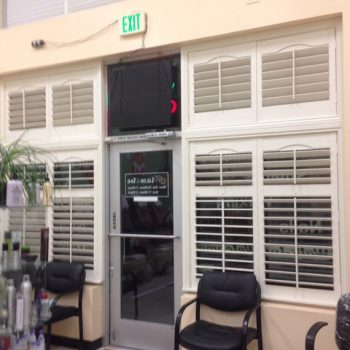 Wooden Shutters on storefront windows